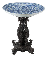 A Blue and White Porcelain Bowl On Carved Hard Wood Stand 35 x 30-1/2 inches (88.9 x 77.5 cm)