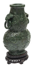 Carvings, A Chinese Spinach Jade Two-Handled Urn on Wood Base. 11 x 6 x 4 inches (27.9 x 15.2 x 10.2 cm). ...