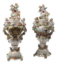 A Near Pair of German Porcelain Floral Covered Urns on Bases, One with Clock, 19th century Marks to bases: (pseud