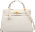 Luxury Accessories:Bags, Hermès 32cm White Togo Leather Retourne Kelly Bag with Gold Hardware and Twilly Scarf. X Circle, 1994. Condition: 4...