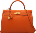 "Luxury Accessories:Bags, Hermès 35cm Orange H Clemence Leather Retourne Kelly Bag with Gold Hardware. O Square, 2011. Condition: 3. 14"" Wid..."