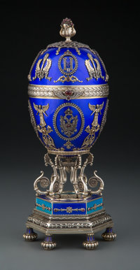 A Silver and Other Metals, Guilloché Enamel, Diamond, and Cabochon-Mounted Standing Egg with Dome-Form Surprise i...