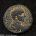 Ancients:Roman, Ancients: Syria, Decapolis. Esbus. Elagabalus. 218-222 C.E. AE 26mm (15.64 g). Radiate, draped and cuirassed bust right / Zeusseated...