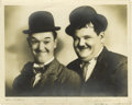 "Movie/TV Memorabilia:Autographs and Signed Items, Stan Laurel and Oliver Hardy Signed Photo. A rare sepia-tone 10"" x8"" photo of the comedy duo, circa the late 1930s, inscrib..."