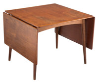 Hans J. Wegner (Danish, 1914-2007) Drop Leaf Dining Table, circa 1950 Teak 28 x 70-1/2 x 34 inche