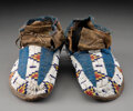 American Indian Art:Beadwork and Quillwork, A Pair of Sioux Beaded Buffalo Hide Moccasins... (Total: 2 )
