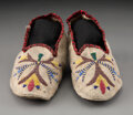 American Indian Art:Beadwork and Quillwork, A Pair of Santee Sioux Beaded Hide Moccasins...