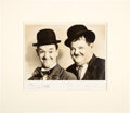 Movie/TV Memorabilia:Autographs and Signed Items, Laurel and Hardy Signed Photo In Matte. Matted to ...