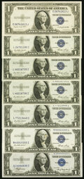 Seven 1935 Series $1 Silver Certificates. About Uncirculated. ... (Total: 7 notes)