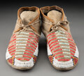 American Indian Art:Beadwork and Quillwork, A Pair of Sioux Beaded and Quilled Hide Moccasins... (Total: 2 )