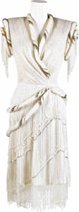 "Music Memorabilia:Costumes, Lynn Anderson Stage Worn Dress. An elaborate -- and heavy -- beaded white dress with gold trim worn on stage by the ""Rose Ga..."
