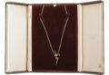 "Music Memorabilia:Props, Elvis Presley Gold ""TCB"" Necklace With Leather Box. After Presley and his friends and employees adopted the ""TCB"", acronym, ..."