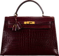 Luxury Accessories:Bags, Hermès Vintage 32cm Shiny Bordeaux Crocodile Sellier Kelly Bag with Gold Hardware. O Circle, 1985. Condition: 4. 1...