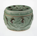 Ceramics & Porcelain, A Chinese Tobi Seiji Decorated Longquan Celadon Covered Jar, Yuan Dynasty, 14th century . 3-1/2 x 4-1/2 inches (8.9 x 11.4 c...