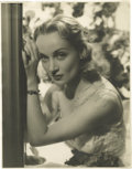 """Movie/TV Memorabilia:Autographs and Signed Items, Carole Lombard Signed Photo. A b&w 11"""" x 14"""" photo of Lombard, inscribed to Emile LaVigne and signed by her in black ink. In..."""