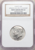 Errors, 1964-D 50C Kennedy Half Dollar -- Struck on 25C Planchet -- MS62 NGC. The strike is almost perfectly centered, with all bor...