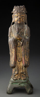 A Chinese Gilt Bronze Diety 12-1/4 x 3-3/4 x 2-3/4 inches (31.1 x 9.5 x 7.0 cm)  Property from the Estate