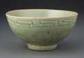 Ceramics & Porcelain, A Chinese Celadon Bowl, Ming Dynasty. 2-3/4 x 5-3/4 inches (7.0 x 14.6 cm). ...