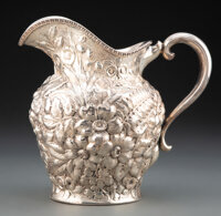A Mauser Manufacturing Co. Repoussé Silver Pitcher, New York, 1887-1903 Marks: (unicorn), STERLING , 2415, 4 PI...