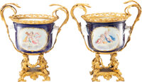 A Pair of Sèvres-Style Gilt Metal Mounted Porcelain Urns, France, 20th century Marks: (pseudo Sèvres marks...