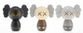 Collectible, KAWS (b. 1974). Kokeshi Doll, from Holiday Series (set of 3), 2019. Painted wood. 4 x 4 x 2 inches (10.2 x 10.2 x 5....