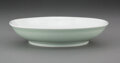 Ceramics & Porcelain, A Chinese Monochrome Porcelain Dish. Marks: Six-character Daoguang mark . 1-1/2 x 6-1/2 inches (3.8 x 16.5 cm). ...