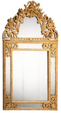 A Continental Carved Giltwood Mirror, 18th century 58-1/4 x 31-1/4 x 3-1/2 inches (148.0 x 79.4 x 8.9 cm)