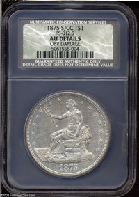 1875-S/CC T$1 --Obverse Damage--NCS. AU Details. FS-012.5. One of the most popular and elusive issues in the Trade dolla...