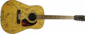 Musical Instruments:Acoustic Guitars, Folk Rock Signed Guitar. A Harmony six-string acoustic covered inliterally hundreds of autographs by various Folk and Folk-...