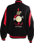 Music Memorabilia:Costumes, Live Aid Tour Jacket. A black cotton jacket with red trim and alarge Live Aid/Hard Rock Cafe 1985 World Tour logo on the ba...