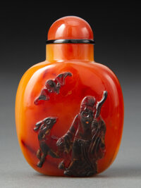 A Chinese Carved Carnelian Agate Snuff Bottle 2-1/2 x 1-3/4 inches (6.4 x 4.4 cm)
