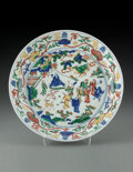 Ceramics & Porcelain, A Chinese Wucai 'Eight Immortals' Dish. Marks: Six-character Wanli mark within double-circles. 11-7/8 x 2-1/4 inc...