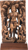 Carvings, An Indian Wood Carving, 19th century. 27-1/4 x 17 x 5-1/4 inches (69.2 x 43.2 x 13.3 cm) on a 4-1/2 inch (11.4 cm) custom wo...