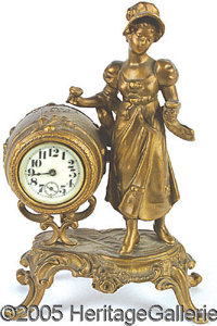 """GIRL WITH WINE CASK ST. LOUIS 1904 WORLD'S FAIR CLOCK. 9-1/4"""" tall girl with glasses in either hand standing beside..."""
