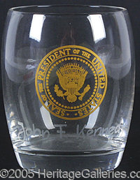 JFK CRYSTAL DRINKING GLASS, PERSONALLY OWNED A PRESIDENT. P P High-quality small glass, with Presidential Seal in gold a...