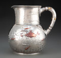 Silver & Vertu, A Tiffany & Co. Hammered Silver and Mixed Metal Water Pitcher, New York, 1877-1891. Marks: TIFFANY & CO, 4706 MAKERS 9838,...