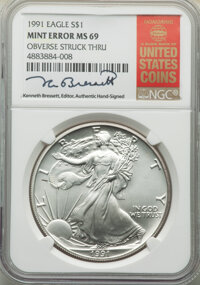 1991 $1 Silver Eagle -- Obverse Struck Thru -- MS69 NGC. The NGC insert is hand-signed by longtime Guide Book editor Ken...