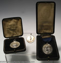 Golf Collectibles:Medals/Jewelry, Three silver medals. Included is a boxed oval medal with ... (5items)