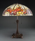 Lighting, Handel Bronzed Table Lamp with Leaded Glass Floral Border Shade, circa 1910. Marks to base: HANDEL. 16-3/4 inches (42.5 ... (Total: 2 Items)