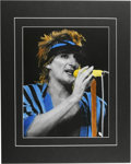"Music Memorabilia:Photos, Rod Stewart Rare Concert Photo Illustration. An 11"" x 14""hand-tinted photo of Stewart, taken during a performance inDallas..."
