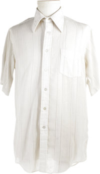 Elvis Owned and Worn Shirt. A white short-sleeved Enro Mr. Tall polyester-cotton shirt, owned and worn by Elvis. In Exce...