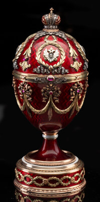 An 18K Vari-Color Gold, Guilloché Enamel, Diamond, and Cabochon-Mounted Standing Egg with Elephant Surprise in th...