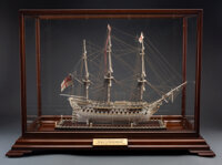 A Carved Bone Napoleonic Prisoner-of-War Ship HMS Conqueror Model with Mahogany and Glass Ca