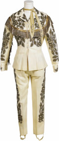 Music Memorabilia:Costumes, Judy Lynn Stage Worn Suit by Nudie Cohn. A cream colored pantsuitdecorated elaborate gold designed, fringe, and rhinestones...
