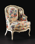 Furniture: French, A Louis XV Style Carved and Painted Upholstered Armchair. Unknownmaker, French. Early Twentieth Century. Painted wood. Un...