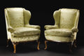 Furniture, A Pair of Georgian-style Upholstered Wing Chairs. Unknown maker, English. Nineteenth century. Walnut solids and veneer, up... (Total: 2 )