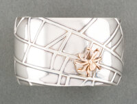 A Tiffany & Co. Silver and Gold Cuff Bracelet, New York, 2001 Marks: TIFFANY & CO., ©2001, 925, 750