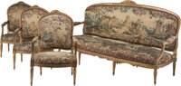 A Four-Piece Louis XVI L M Pluvinet Carved Giltwood Fauteuil and Canapé Suite with Aubusson Tapestry Upholstery...
