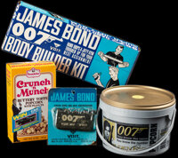 "James Bond Lot (1965-1985). Very Fine+. Finger, Hand and Arm Strengthener (5"" X 6"" X .5""), Empty Popcorn..."