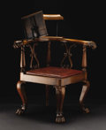 Furniture, A George III-style Corner Reading Chair. Unknown maker, English. Nineteenth century. Mahogany, iron, brass, upholstery. Un...